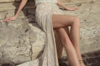 33 sparkling beaded wedding dress with spaghetti straps and a slit