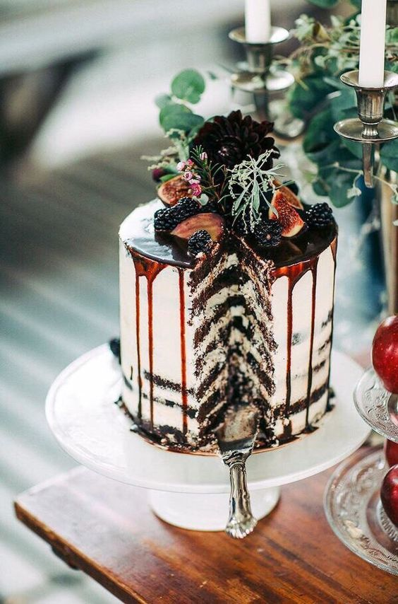 chocolate semi naked cake with chococlate drip, figs and blackberries