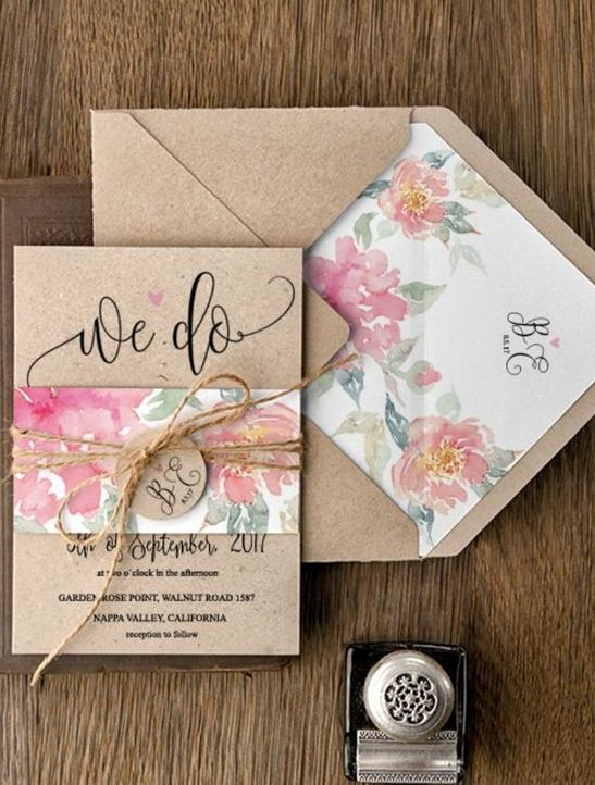 rustic kraft paper envelopes and colorful flowers inside, twine