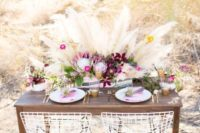 35 bold desert-inspired centerpiece with pink, burgundy flowers and pampas
