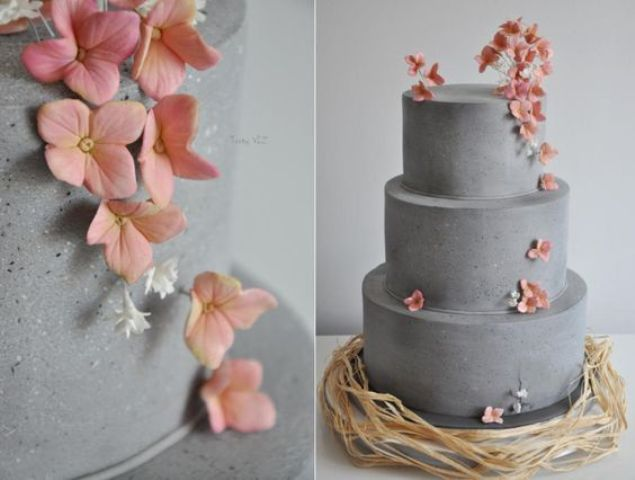 concrete three-layer wedding cake with peach-colored flowers