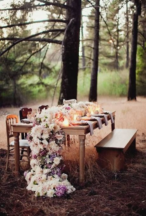 lush floral table runner transforms a rustic outdoor table
