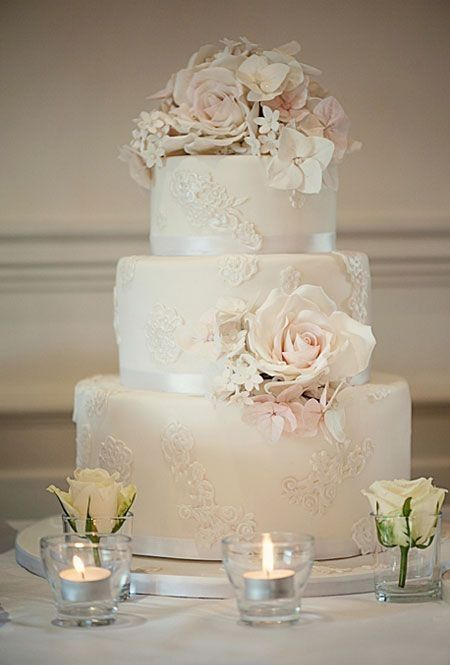refined neutral lace wedding cake topped with blush flowers