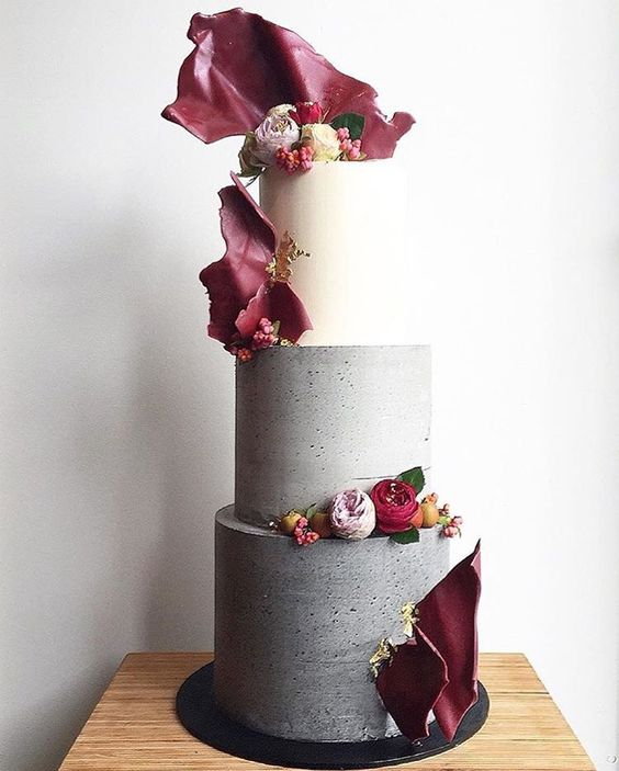 bold concrete cake with red bark decor