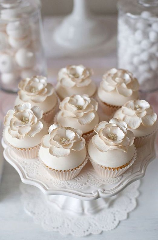 neutral-colored cupcakes with edible cream flowers