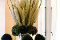 38 plumes of pampas grass with gladiolus in a tall vase