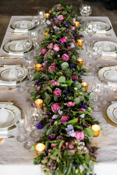 wedding tablescape with a lush colorful floral garland