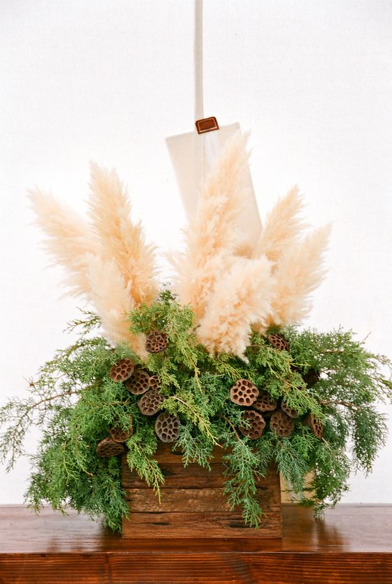wooden crate with evergreens, pampas and lotus