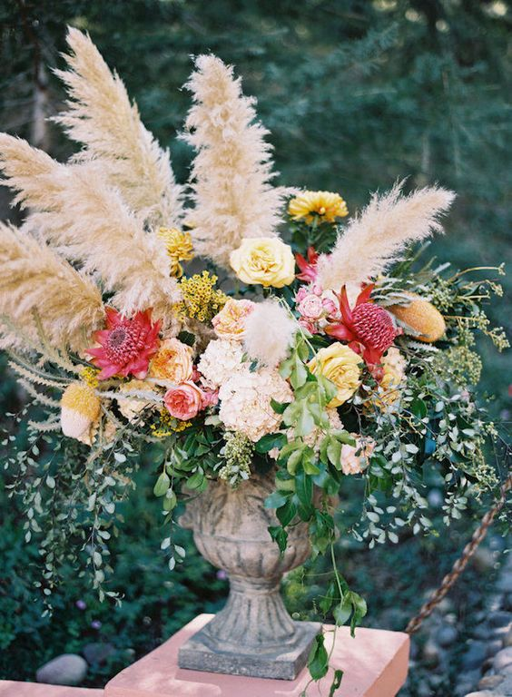 gorgeous lush arrangement with colorful flowers and pampas