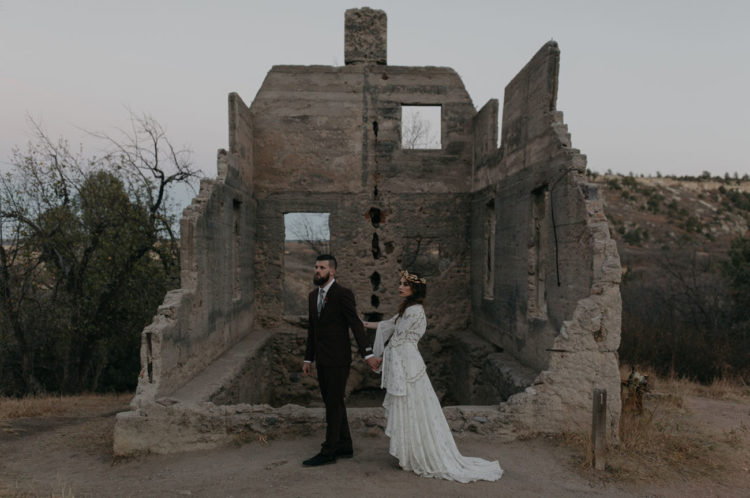 This dark and moody wedding shoot took place in castle ruins
