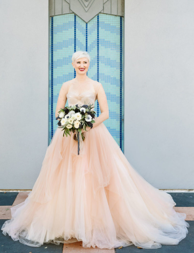 The bride was rocking a stunning blush wedding gown and looked aw-so-gorgeous