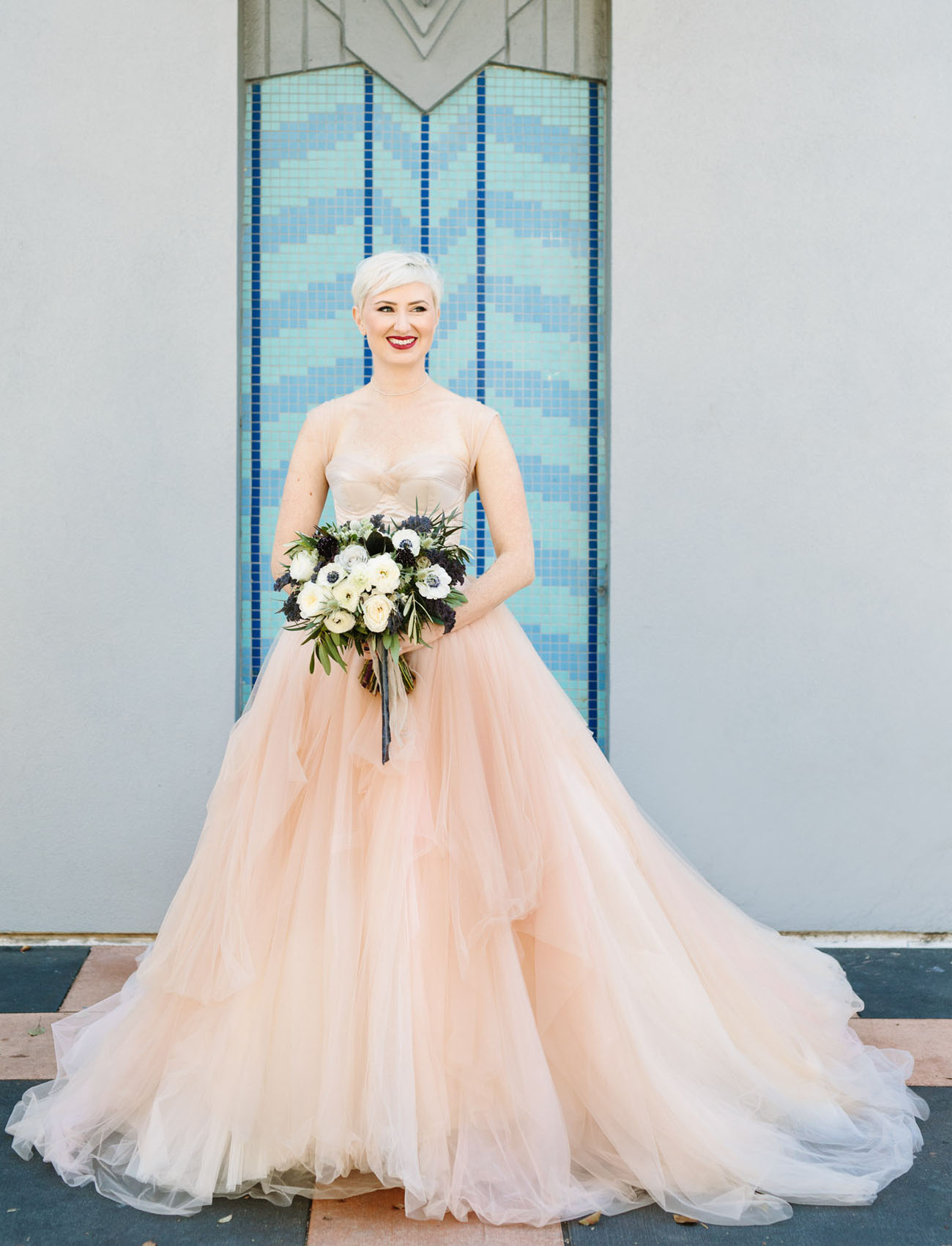 The bride was rocking a stunning blush wedding gown and looked aw so gorgeous