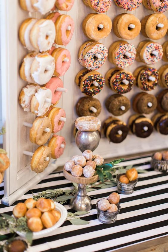 a donut bar organized on a board with hooks