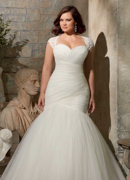 34 jaw dropping plus size wedding dresses weddingomania for Wedding dresses for larger figures