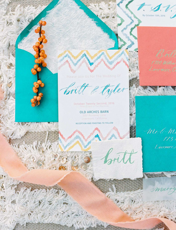 the adorable wedding stationary set was done in turquoise, orange and blue
