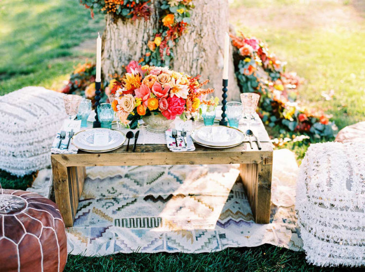 Such a colorful tablescape can work for many seasons including autumn with these bold florals and turquoise glasses