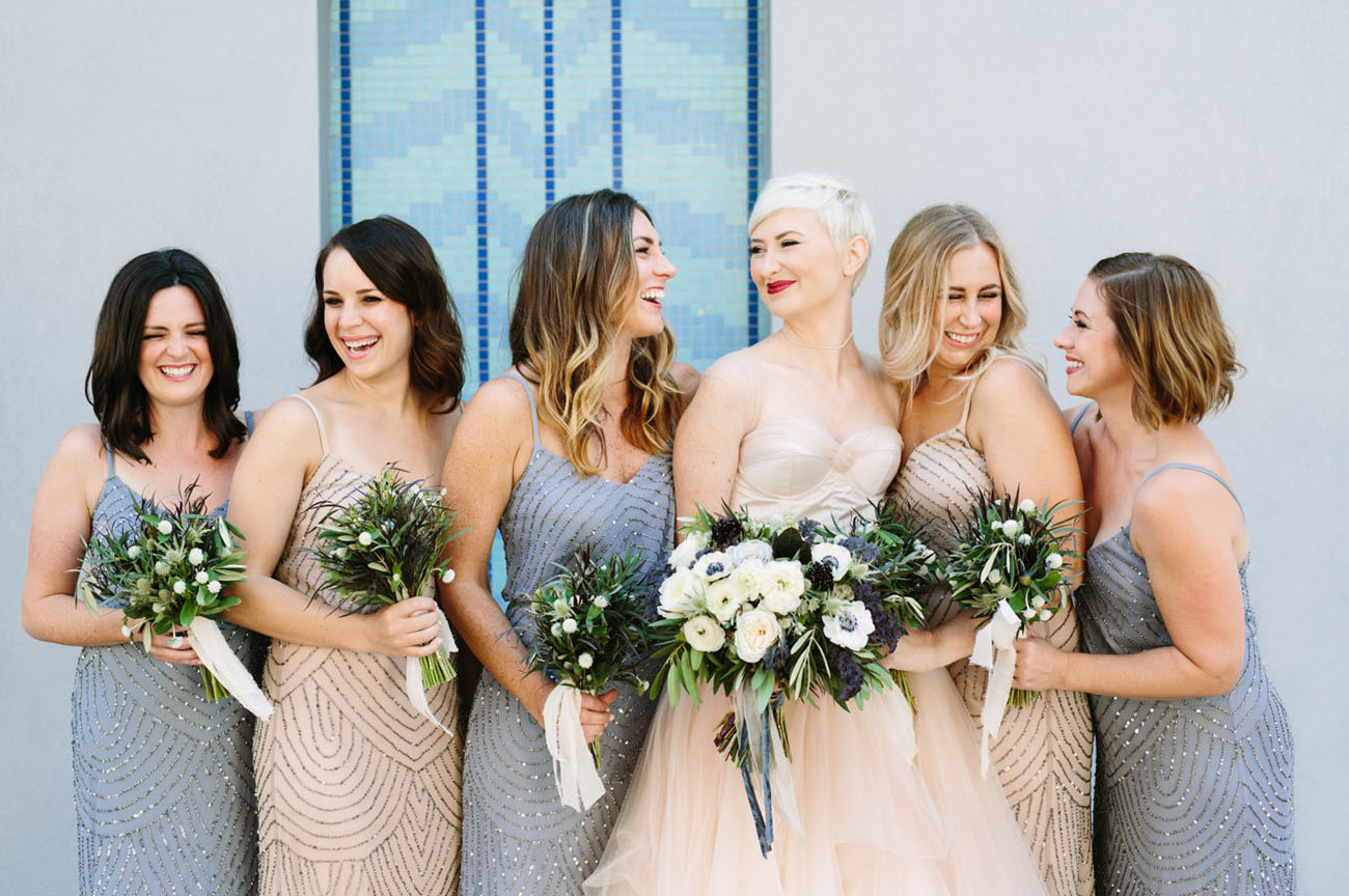 The bridesmaids were rocking matching sparkling gowns of different colors