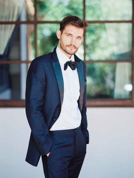 The groom was rocking a navy tuxedo with a white shirt and looked chic
