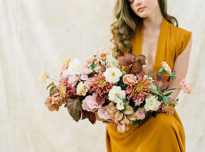 The wedding bouquet was done in cool fall shades and with even fall brown leaves