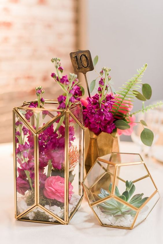 a combo of terrariums and a faceted vase as a centerpiece