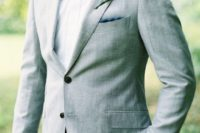 03 a light grey suit with a white shirt and a patterned bow tie