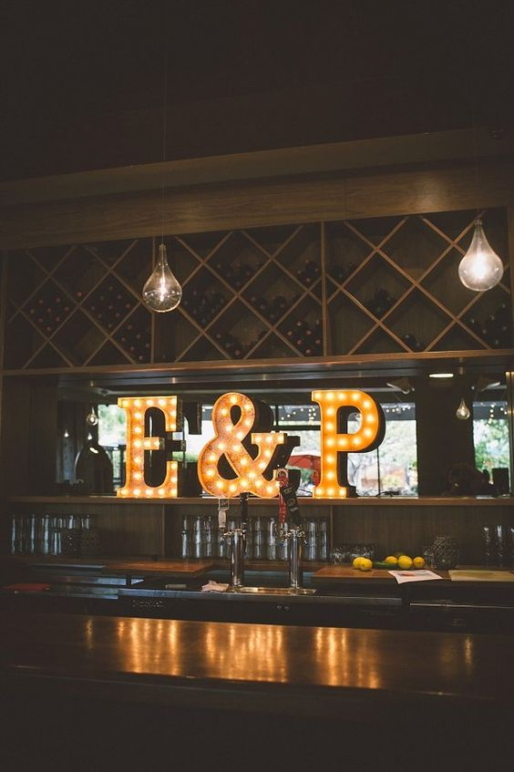 accetuate the bar zone with monogram marquee letters