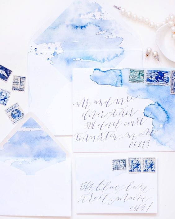 beautiful watercolor blue wedding stationary in shades of blue and purple
