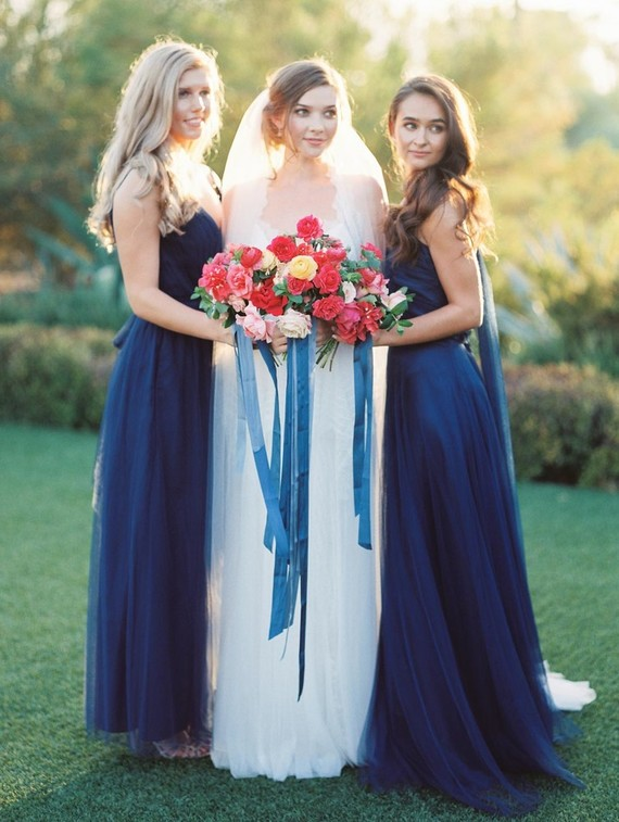 The bridesmaids were also dressed in navy, these were flowy mismatched dresses