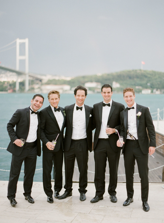 The groomsmen and the groom himself were wearing classic black tuxedos