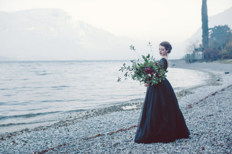 The second bride prefered a black wedding dress with a lace bodice and a layered tulle skirt