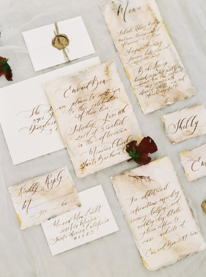 The stationary was done in vintage style, with stamps and elegant calligraphy