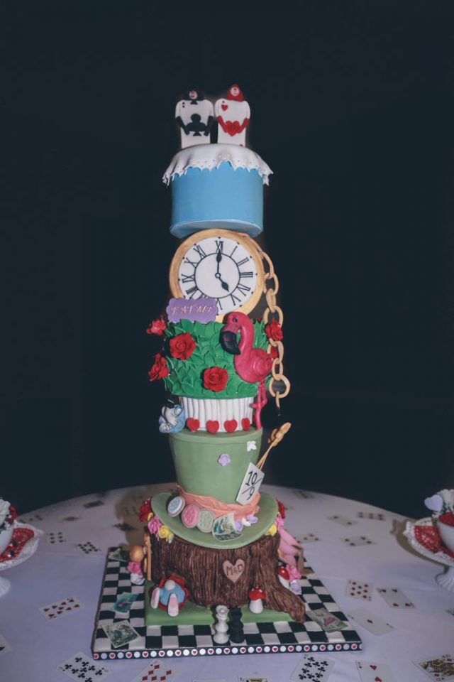 The wedding cake was a real Mad Hatter-inspired masterpiece, tall and colorful
