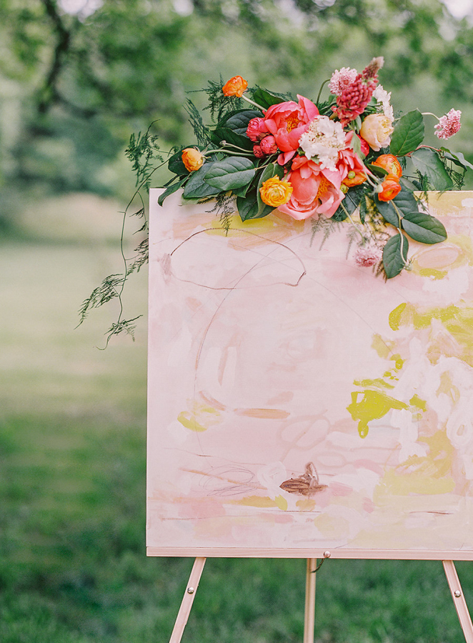 This adorable watercolor painting with bold florals helped to create an ambience