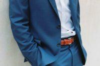 04 a blue suit, a light blue shirt, a mint bow tie and ocher shoes