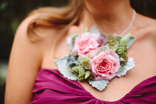 a floral necklace to accessorize the bridesmaid's dress