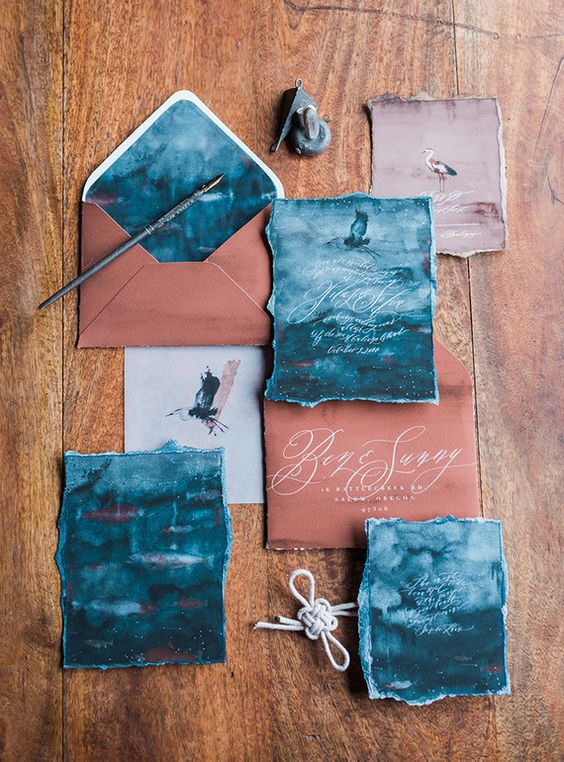 copper-colored envelopes and indigo watercolor invites look bold and unique