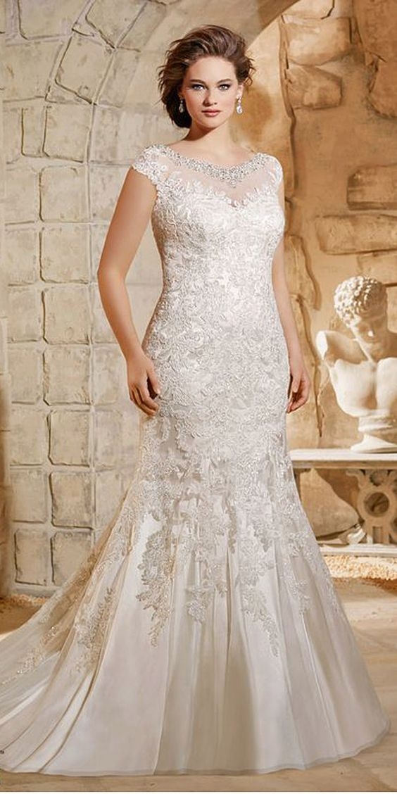 lace beaded illusion neckline wedding gown with cap sleeves and a mermaid silhouette