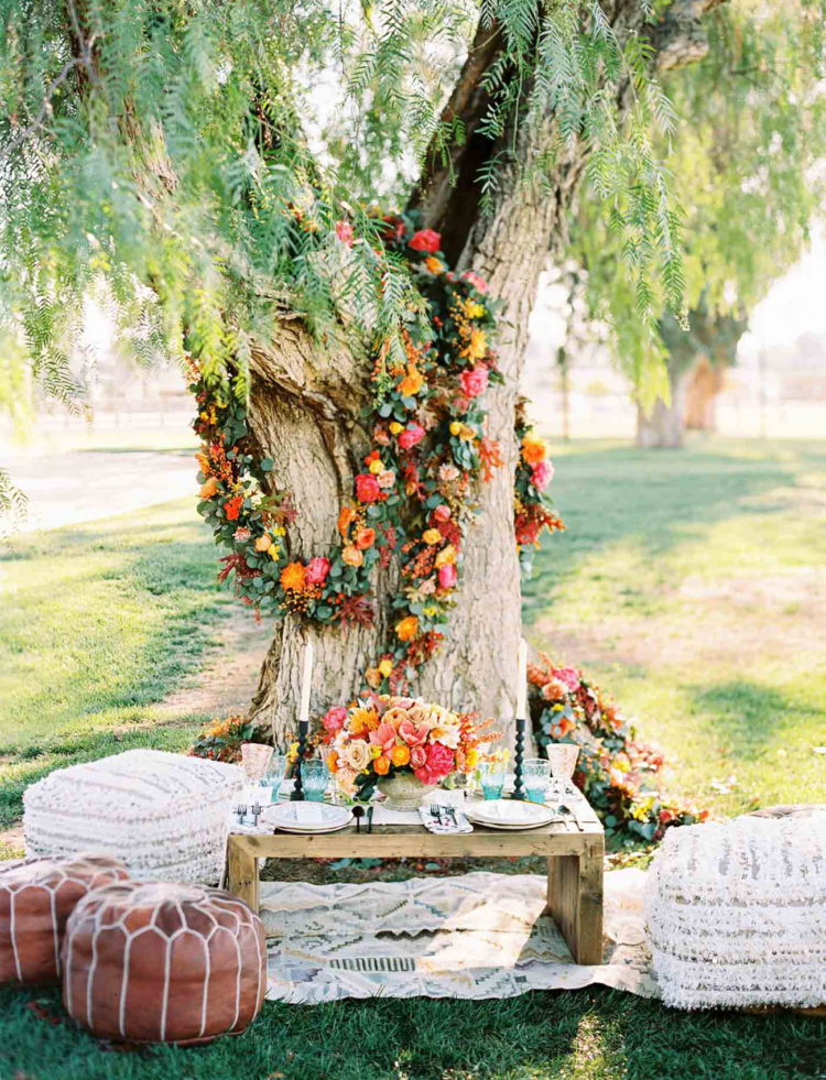 The reception is boho-inspired, with a macrame table runner, crocheted poufs and Moroccan-style ottomans