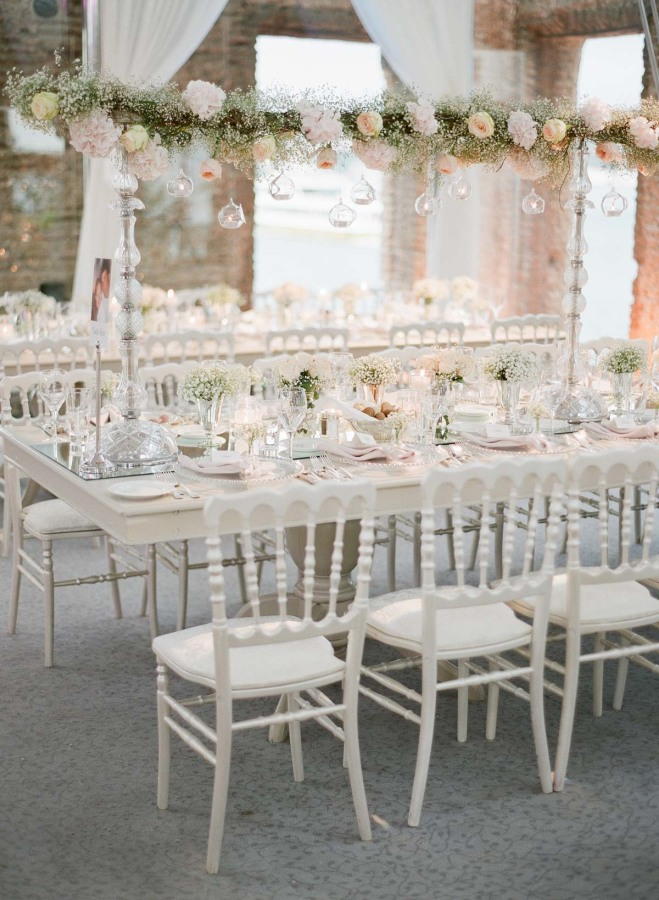 The reception was romantic, with blush flowers and baby's breath arches over the tables