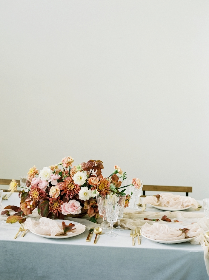 The table setting was pure fine art, with a bold fall-inspired centerpiece and flowy ethereal fabrics