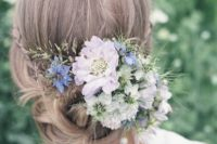 05 braided and twisted messy updo with lots of fresh blooms