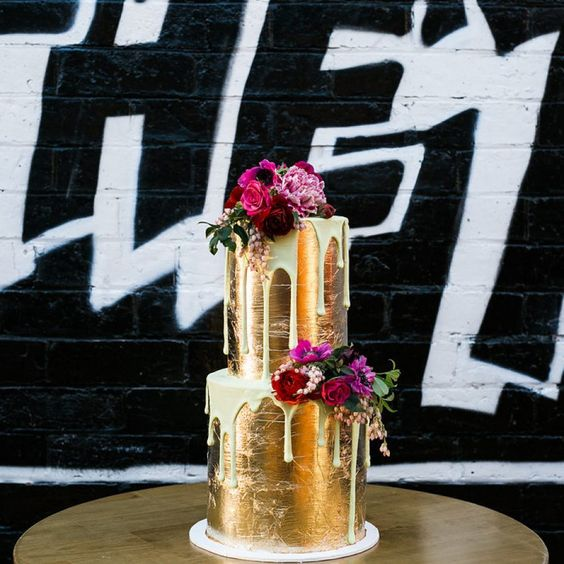 gold leaf drip wedding cake with bold flowers
