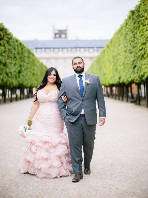 strapless blush wedding dress with a ruffled skirt