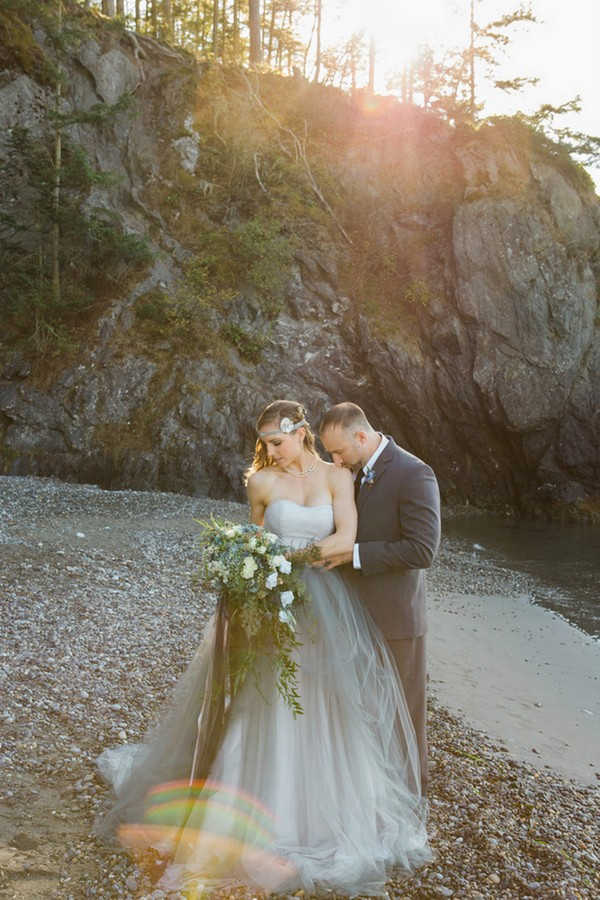 The bride was rocking a slate grey tulle skirt and a light blue strapless top, a corresponding headpiece