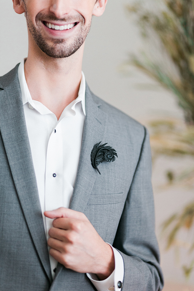 The groom was rocking a light grey suit with no tie and a whimsy boutonniere