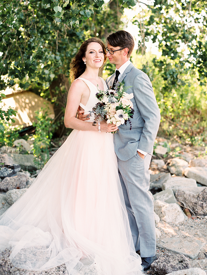 The groom was wearing a light grey suit, a white shirt and a black tie