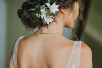 06 braided and twisted updo with hanging locks and flowers on one side