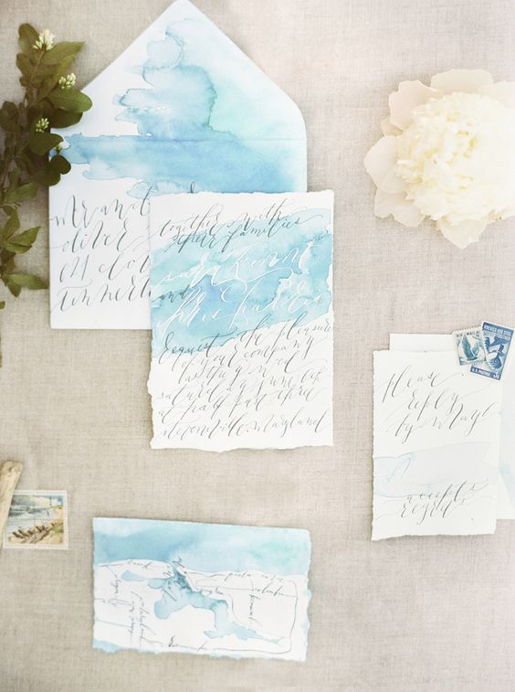 light blue watercolor wedding stationary looks dreamy