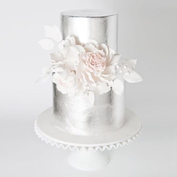 silver wedding cake with edible white cream flowers