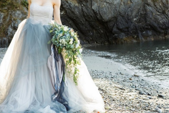 A cascading greenery bouquet is a perfect fit for her look